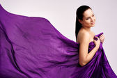 Woman in purple long dress — Stockfoto