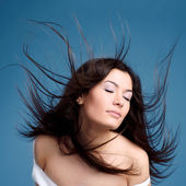 Beautiful young woman with hair flying — Stock Photo