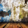 Stock Photo: Grunge painted wall and wooden floor in room