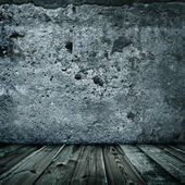 Stylish grunge wall texture and wooden floor — Stockfoto