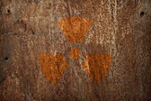 Nuclear radiation sign on rusty metal texture — Stock Photo