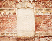 Grunge brick wall with blank frame in the centre — Stock Photo