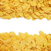 Cornflakes background with copy space in the centre — Stock Photo