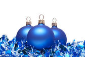Blue christmas balls with tinsel isolated on white — Stock Photo
