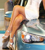 Girl on the car hood — Stock Photo