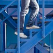 A man running up the stairs — Stock Photo