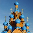Wooden Church with Blue Domes — Stock Photo