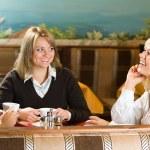 Three young women talking — Stock Photo