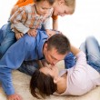 Happy family on the carpet — Stock Photo #2916224