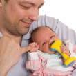 Father holding newborn daughter — Stock Photo