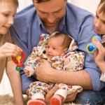 Dad and three children — Stock Photo