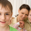 Boy with mother and brothers — Stock Photo