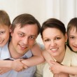 Parents are on the carpet with sons — Stock Photo #3208970