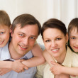 Royalty-Free Stock Photo: Parents are on the carpet with sons