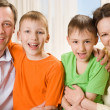 Parents are on the carpet with sons — Stock Photo