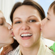 Little brothers kissing his mom — Stock Photo