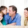 Laughing a family of four — Stock Photo #3209018
