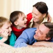 Laughing a family of four — Stock Photo