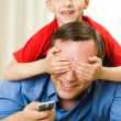Son and father lying - Stock Photo