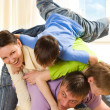 Happy family fun playing — Stock Photo
