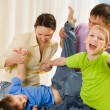 Parents play with their sons — Stock Photo