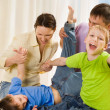 Stock Photo: Parents play with their sons