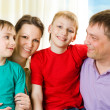 Happy family four — Stock Photo