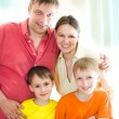 Family of four on a white — Stock Photo #3209463