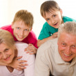 Happy elderly with children — Stock Photo