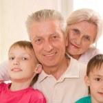 Happy elderly with children — Stock Photo