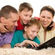 Beautiful familywith a laptop — Stock Photo #3209553