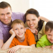 Stock Photo: Happy parents with children
