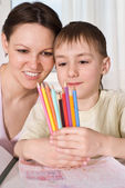 Young mother sits with son — Stock Photo