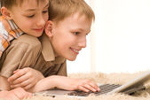 Brothers with laptop — Stock Photo