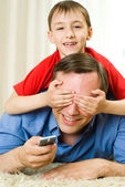 Son and father lying — Stock Photo