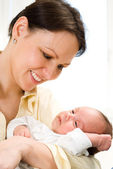 Young mother and baby — Stock Photo