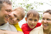 Happy boys with family in the summer park — Stock Photo