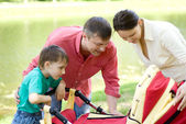 Family in the summer park — Stock Photo
