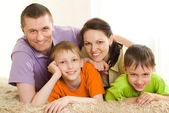 Happy parents with children — Stock Photo