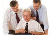 Businessmen working at a table — Stock Photo