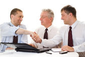 Three businessmen on a white — Stock Photo