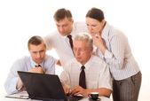 Four businessmen working — Stock Photo