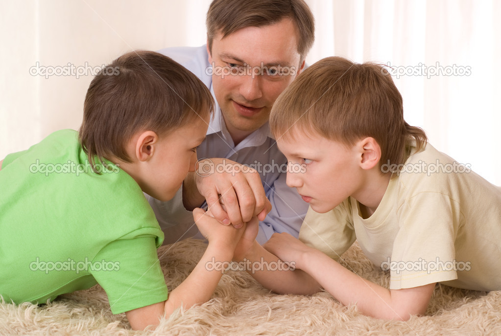 Young father playing with his two children — Stock Photo #3208966
