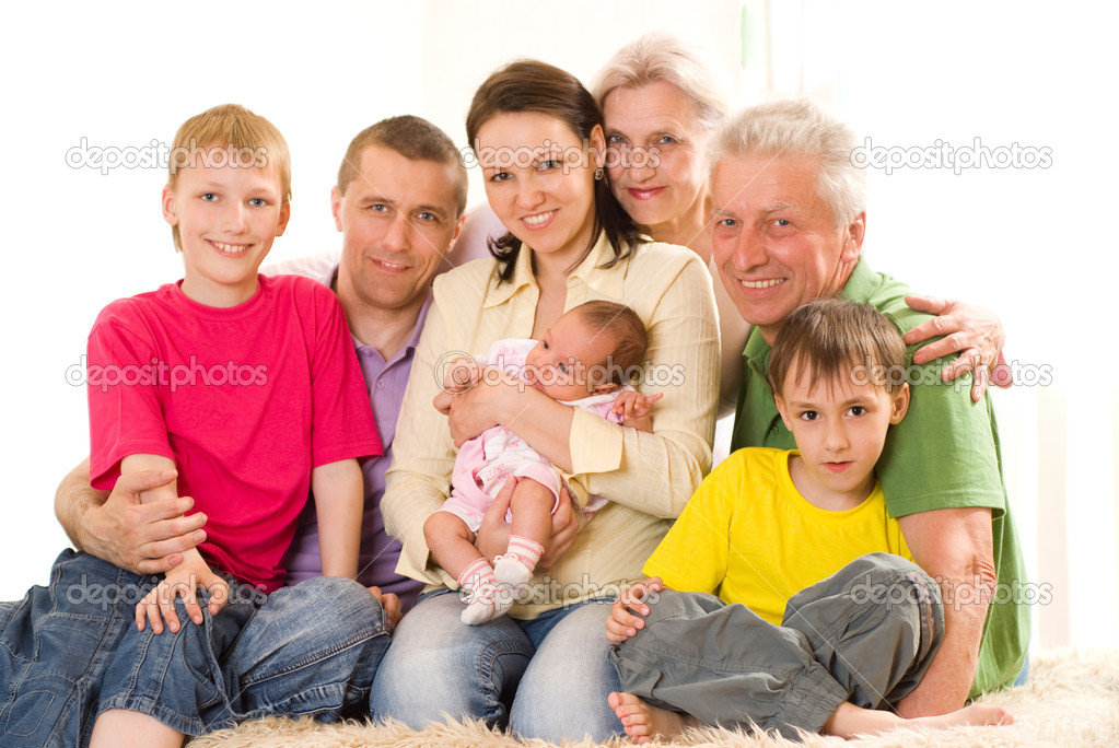 Portrait of a happy family of seven on a light — Stock Photo #3209525