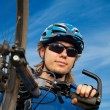 Portrait of a young bicyclist in helmet - Stock Photo