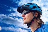 Portrait of a young bicyclist in helmet — Stockfoto