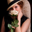 Nice woman with a rose — Stock Photo