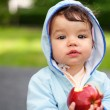 Kid with apple — Stock Photo