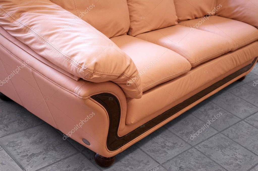 Modern pink sofa on marble to a floor — Stock Photo #3667978