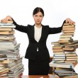 Girl and two large piles of books — Stock Photo #3038835
